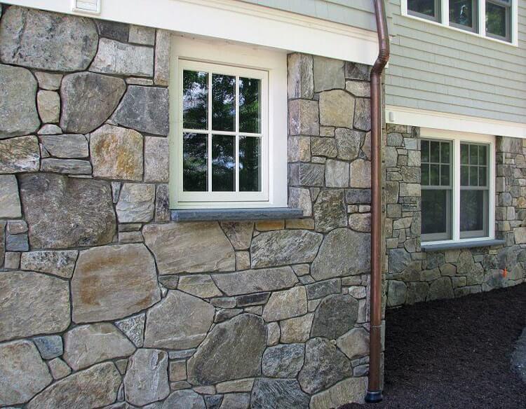 отделка цоколя жилого дома искусственным камнем